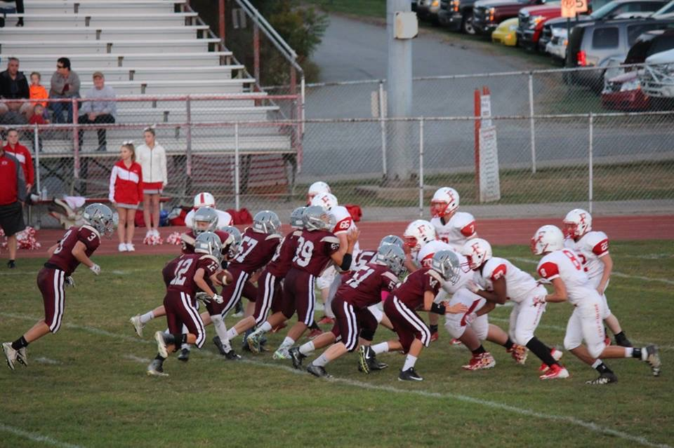 MS Football - The line doing its job!  Running back coming through!