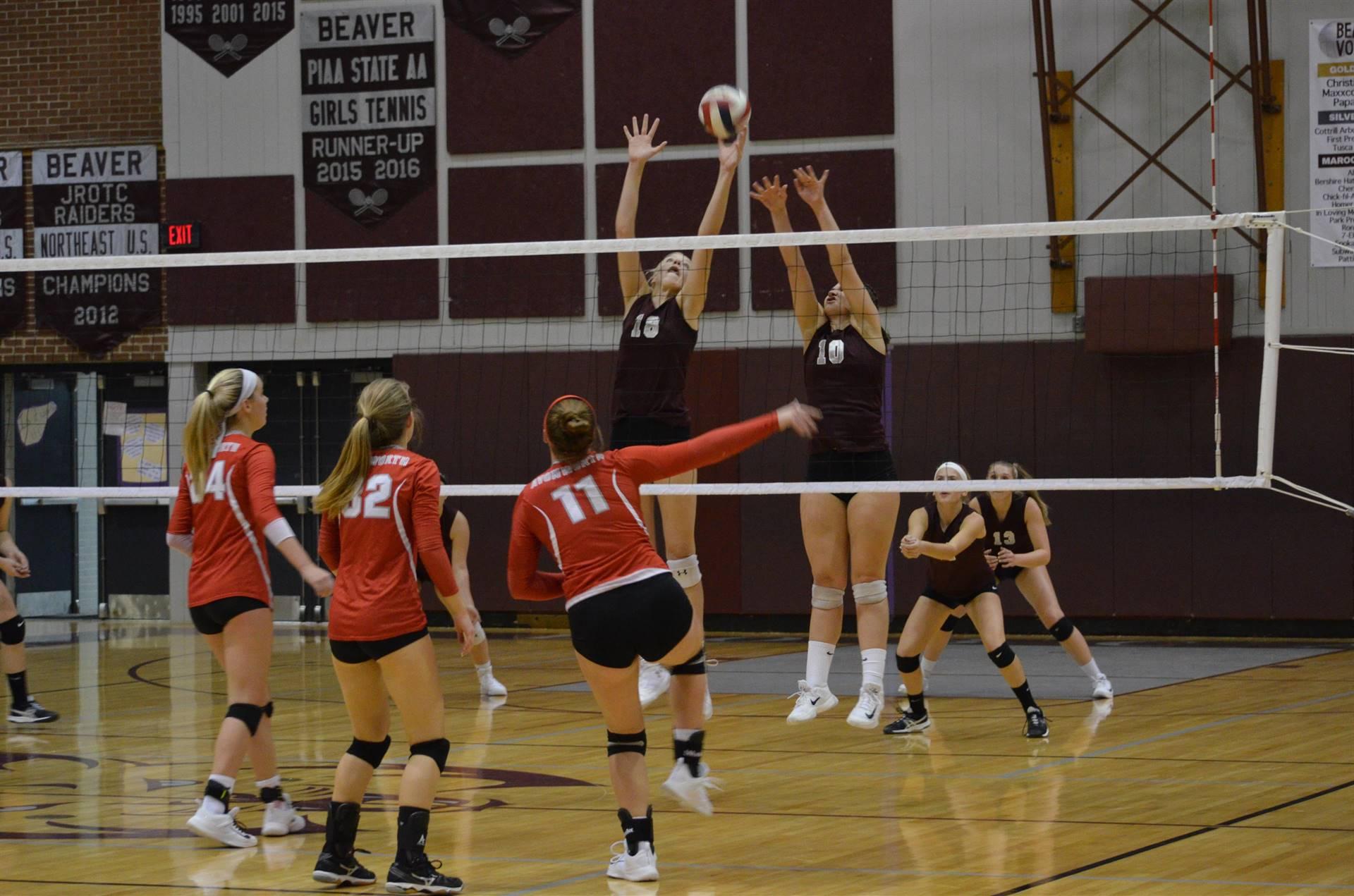 Varsity girl's volleyball - Blocking the shot!