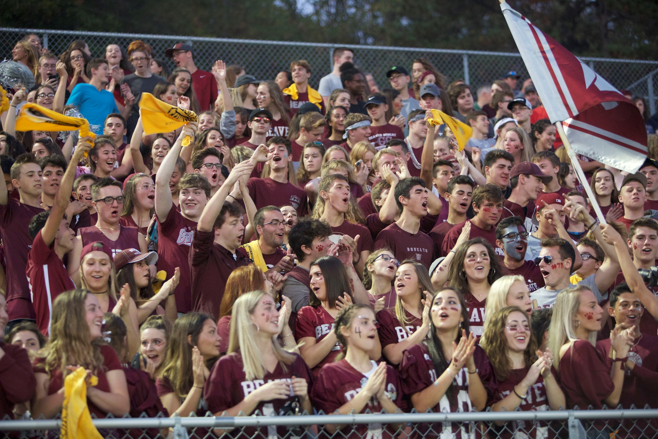 Student cheering section at the Homecoming football game