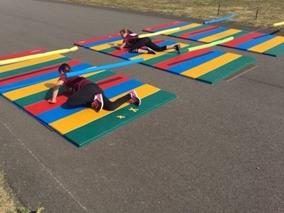 Two students on obstacle course during Jog-a-Thon at Dutch Ridge Elementary School