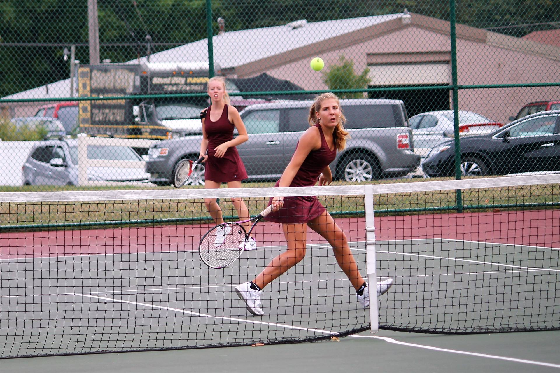 Varsity Tennis - Anna and Grace double teaming the opponent!