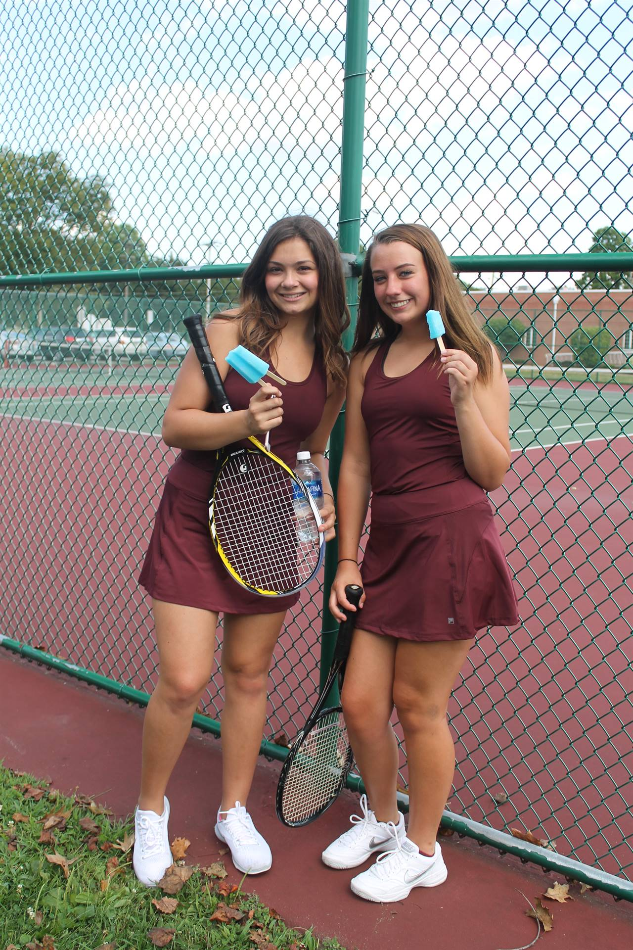 Varsity Tennis - Emily and Alaina chilling after the match!
