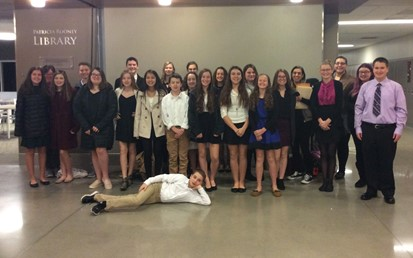 Twenty-two students and their two sponsors posing at the Forensics Competition at Cardinal Wuerhl-North Catholic High School