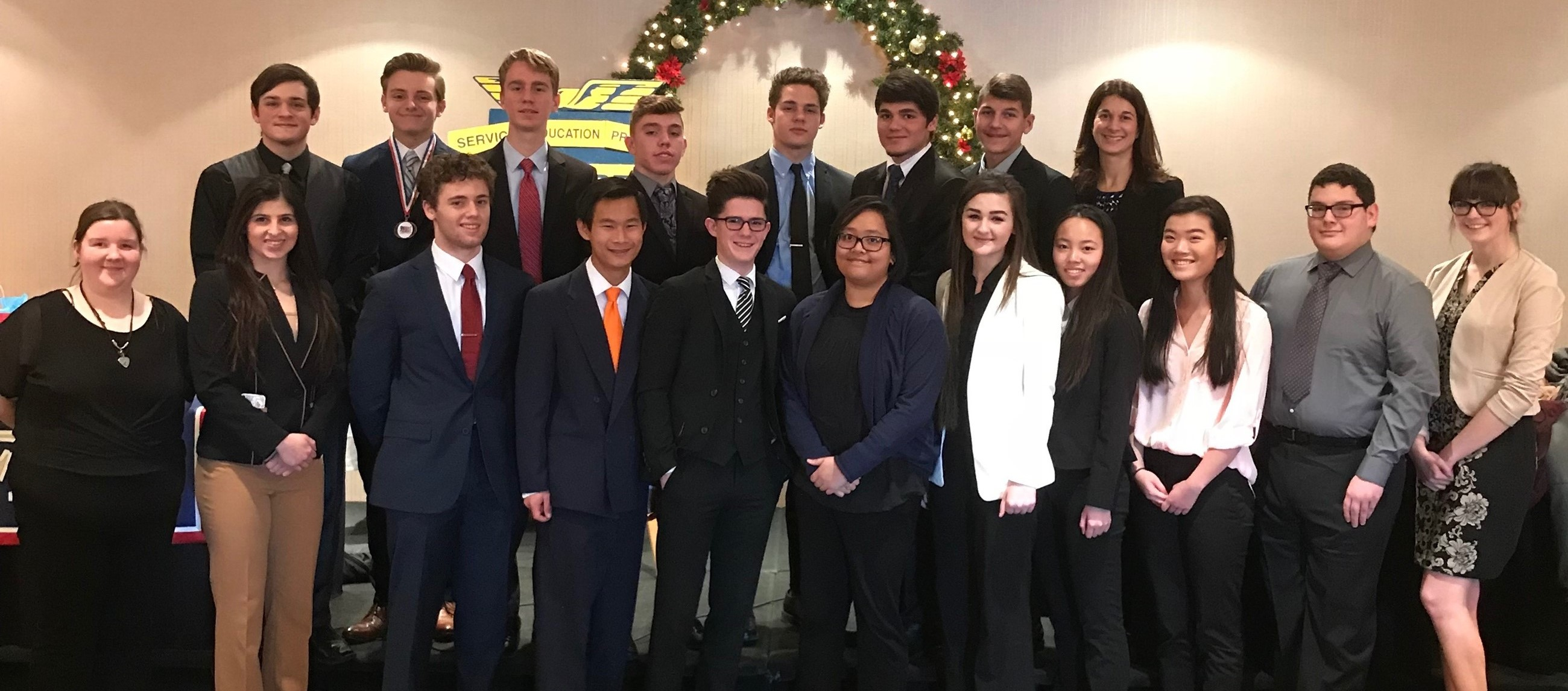 Eighteen students and their sponsor competing at Future Business Leaders of America Regional Competition