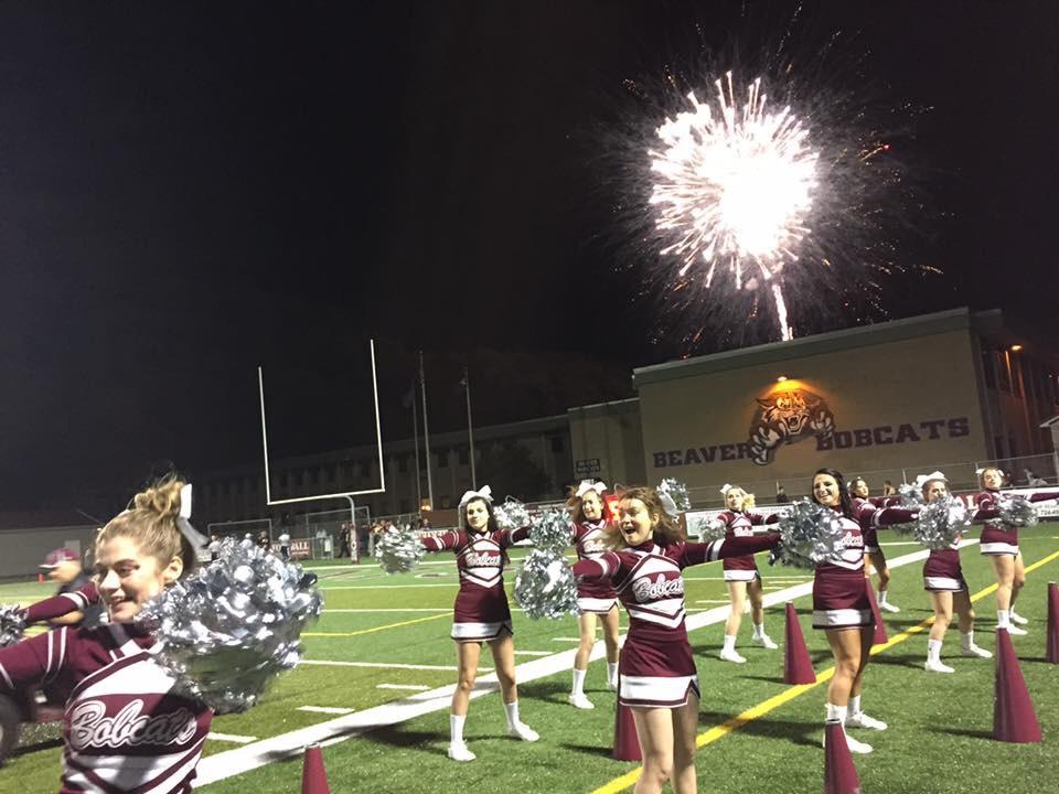 Touchdown! - Varsity cheerleaders celebrating a touchdown.