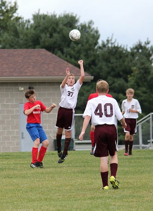 MS Boy's Soccer - Getting to the ball first.