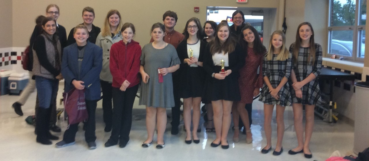 Fourteen students and their advisor at the Forensics Competition at Upper St Clair