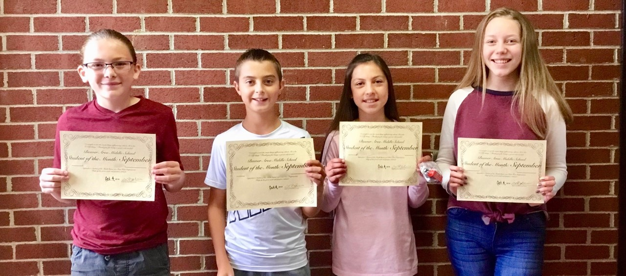 Middle School Students of the Month for September 2018 - Four students holding certificates