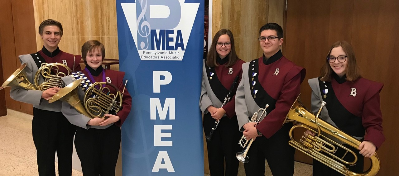 PMEA Honors Band 5 students with their instruments