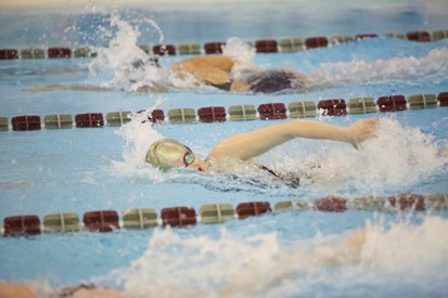 Action shot of three swimmers in a race
