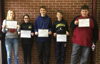 Five Middle School Students of the Month for February holding certificates