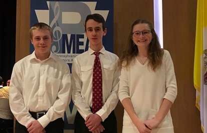 Three students who attended District Band