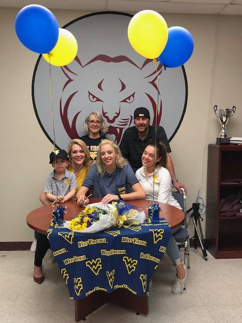 Macy McElhaney signs!