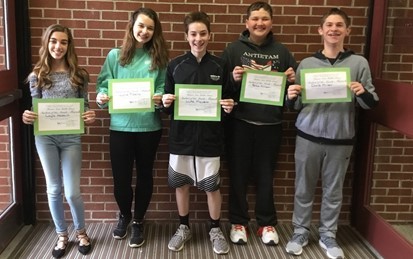 Five Middle School Students of the Month for April 2018 Holding certificates