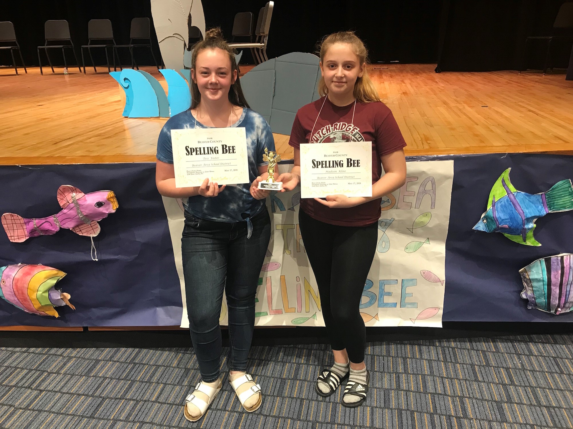 Two students holding certificates from the Beaver County Spelling Bee