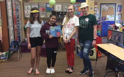 Four Middle School Students at StoryWalk