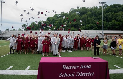 Graduation Ceremony with caps thrown in the air
