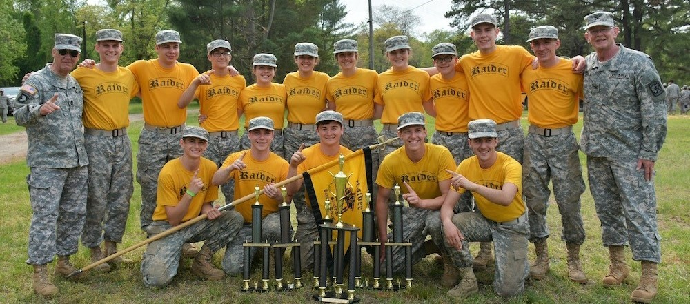 JROTC Raider Team 15 Students and 2 Instructors with trophies for 1st Place