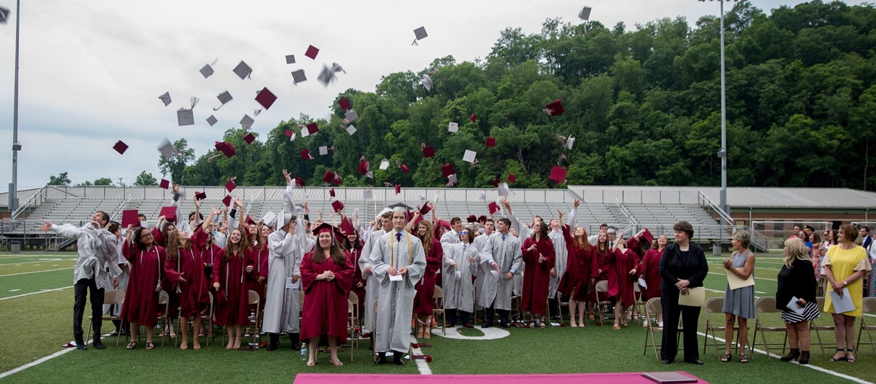 Graduating Class of 2018 throwing caps in the air