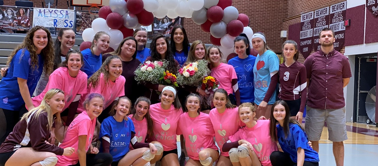 Volleyball team celebrating Senior Night