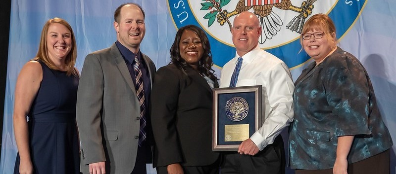 Beaver Administrators and teacher accepting the National Blue Ribbon Award