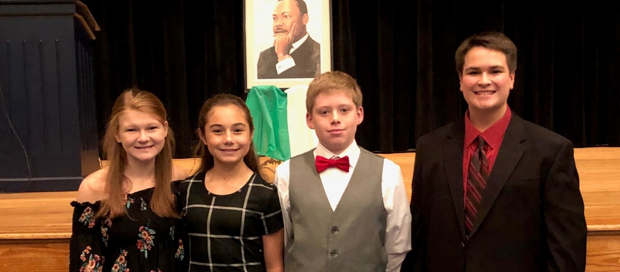 Four students who competed in the Martin Luther King Jr. Oratorical Contest