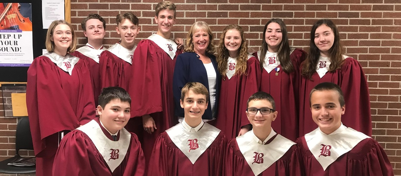 Eleven chorus members and their teacher at County Chorus