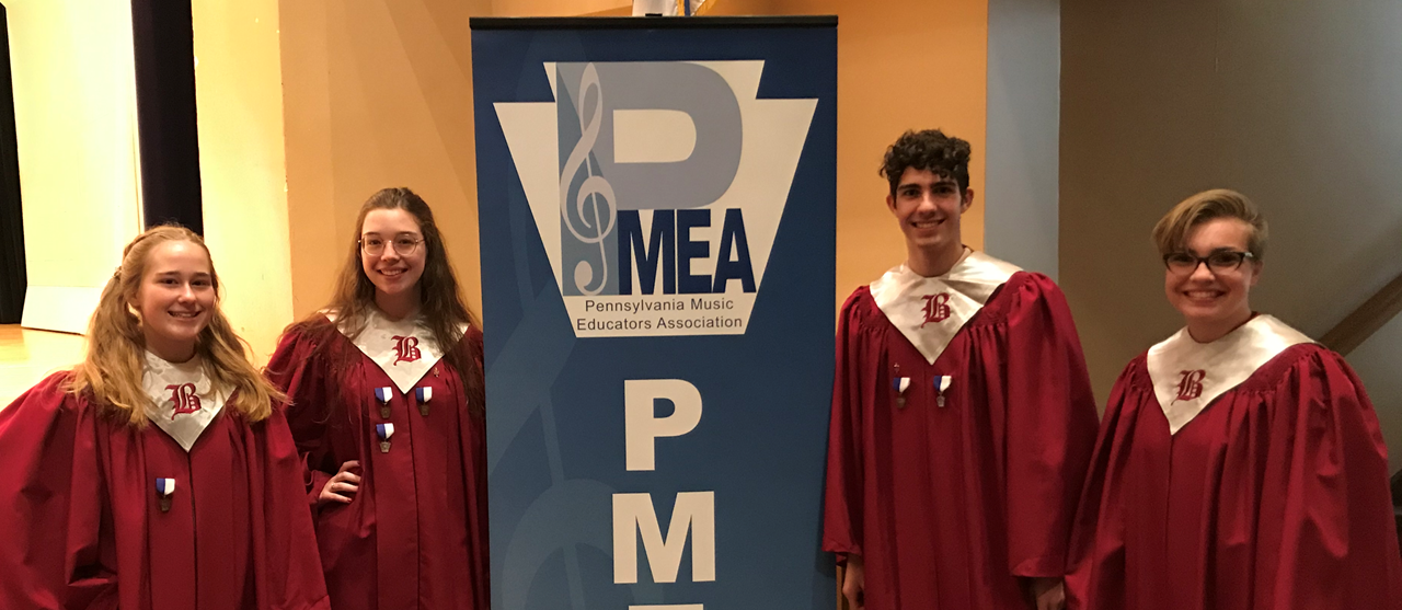 Four students who participated in PMEA Honors Chorus at Westminster College