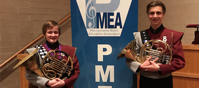 Two student who participated in Region Band Festival holdling French Horns