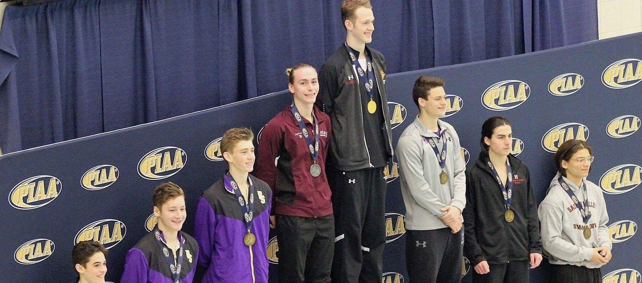 Eight students on the podium at States for Diving