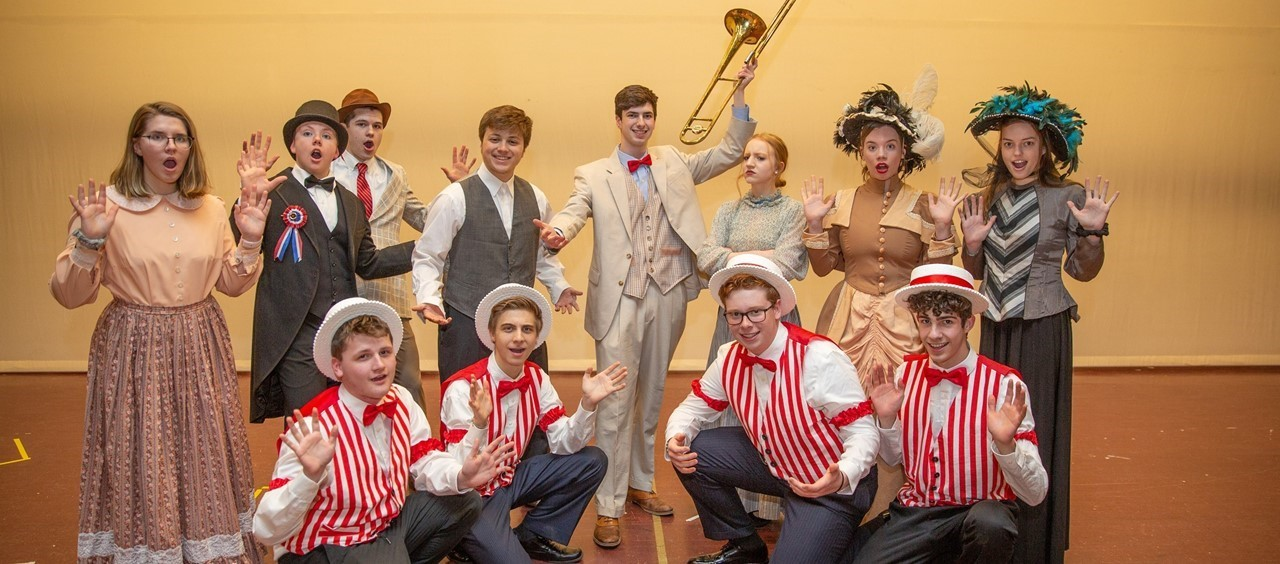 12 students in costume for Music Man