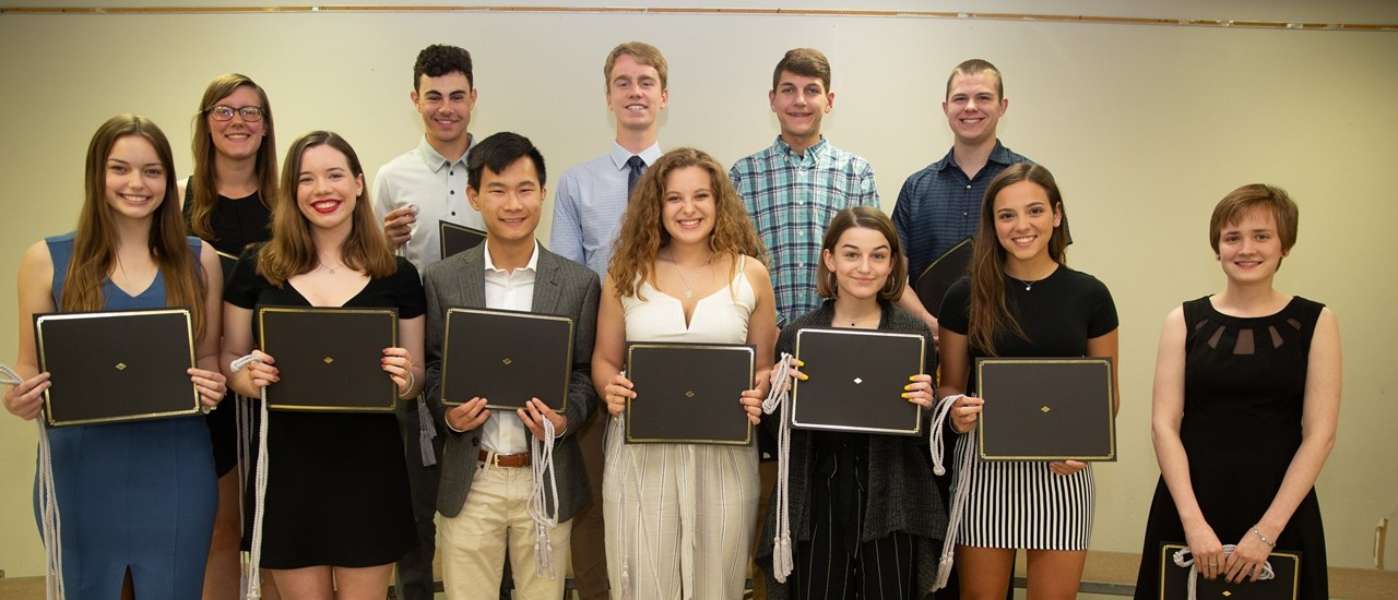 12 Honor Students from the Class of 2019 holding certificates