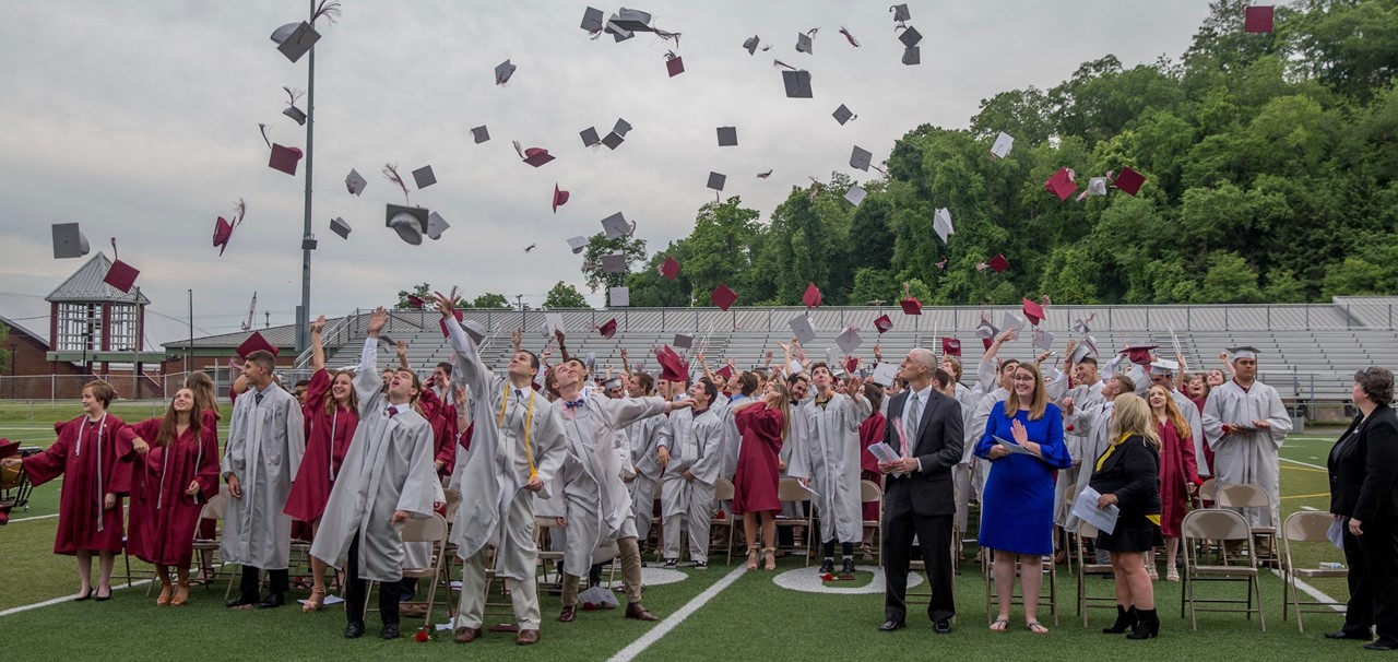 The Class of 2019 celebrates by tossing their caps in the air!