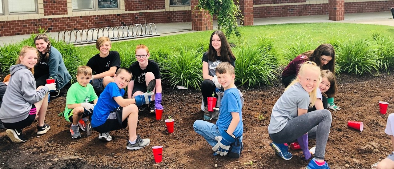 Eleven students working on a planting project at Dutch Ridge Elementary