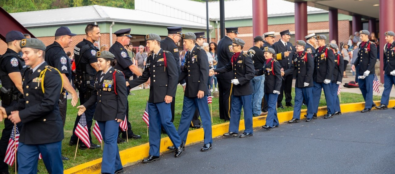 JROTC Cadets shaking hands with First Responders at the 9/11 Ceremony