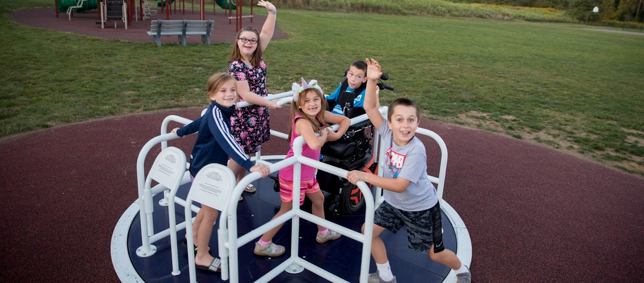 Children playing on the new merry-go-round at Dutch Ridge Elementary School