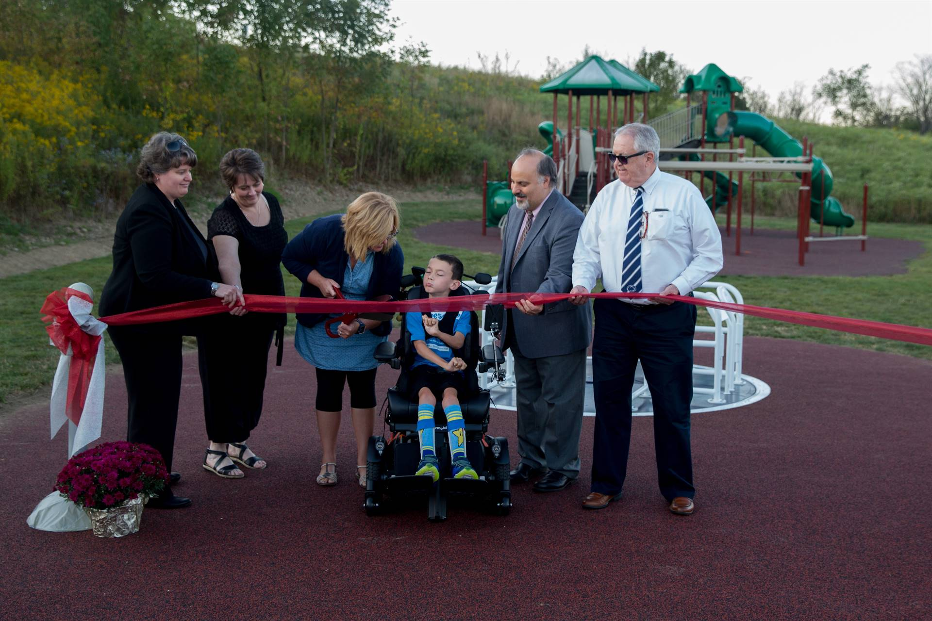 Ribbon cutting ceremony for the new playground equipment at Dutch Ridge