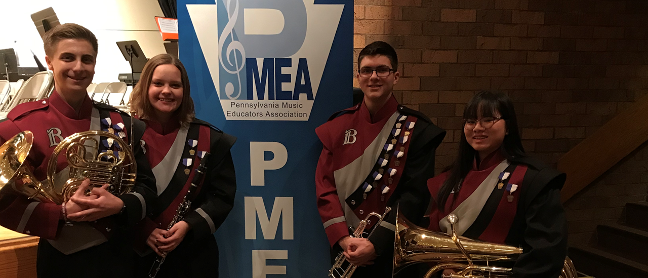 Four musicians at PMEA District Band Music Festival