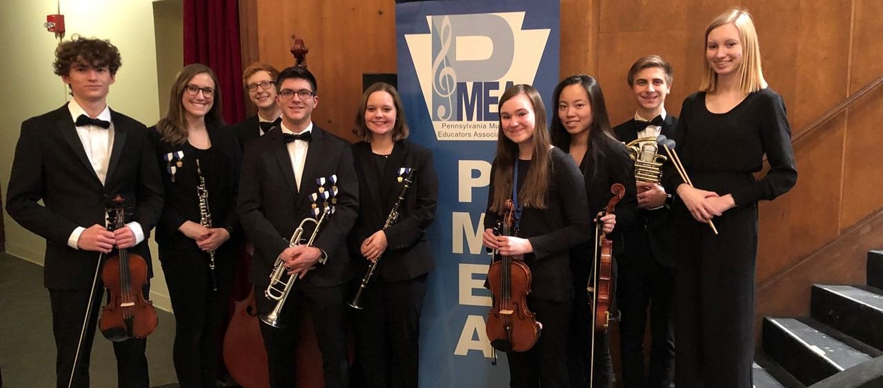 Nine musicians at PMEA District 2,3,5 Orchestra at Indiana University of PA